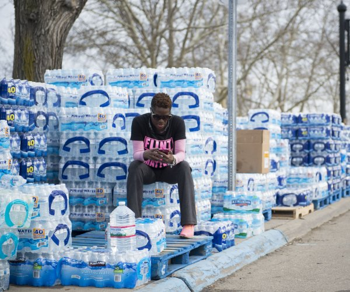 Judge orders trial of Michigan health director over Flint water crisis