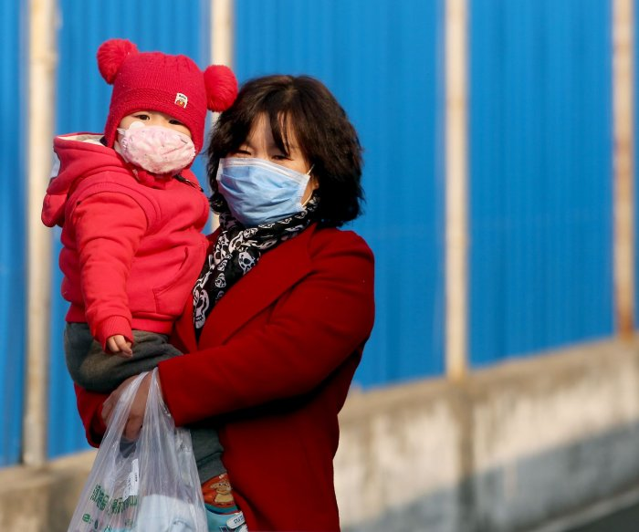 Coronavirus cases slow in China as clusters grow worldwide