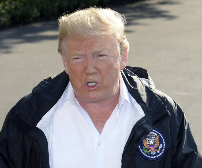 Trump visits Carolinas as Florence death toll rises to 37