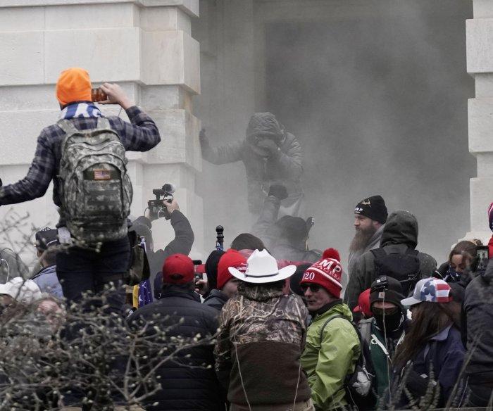 FBI releases photos of men accused of beating cop in Capitol siege