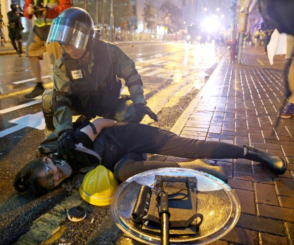 Police: First shot fired in Hong Kong protest 'necessary'