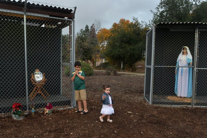 California church Nativity depicts Jesus, Mary and Joseph as caged refugees