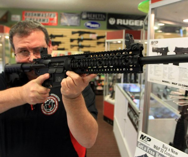 Faith group, shareholders force gunmaker to research safety