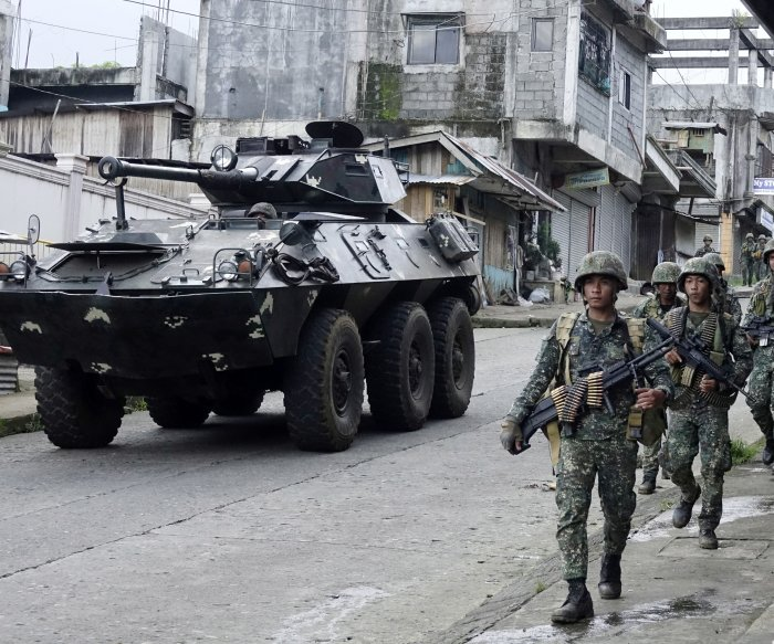 Philippines military: 16 bodies found were civilians fleeing militants