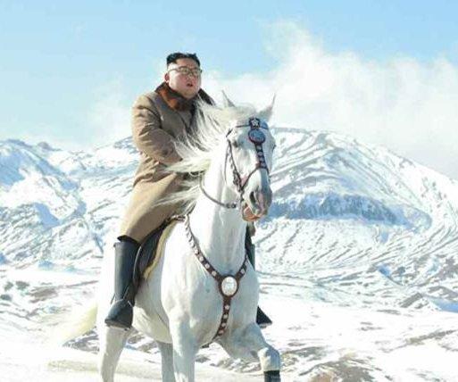 Kim Jong Un shown 'horsing' around on snow-covered Mount Paektu