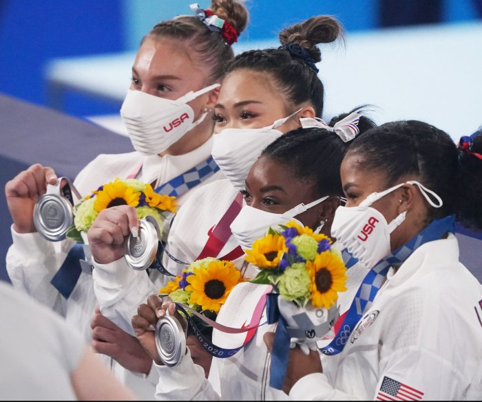 Gymnasts, swimmers help Team USA take medal count lead