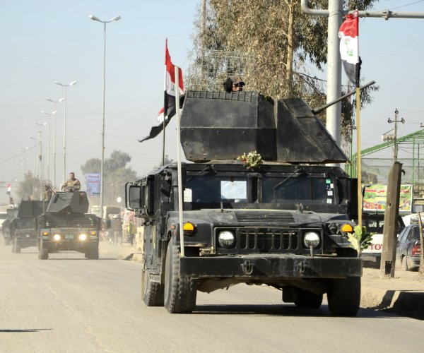 Iraqi forces inside west Mosul after taking military base