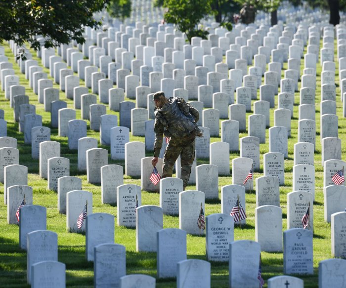 Old Guard places flags at Arlington Cemetery for Memorial Day