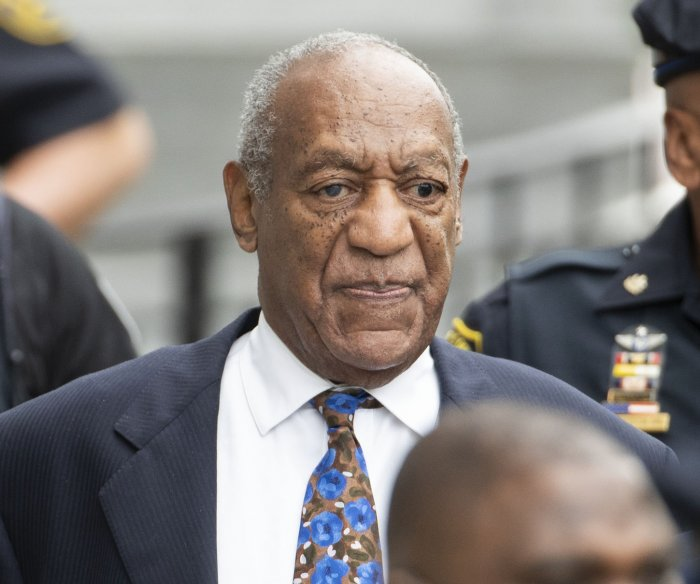 Bill Cosby faces shorter sentence as judge merges charges