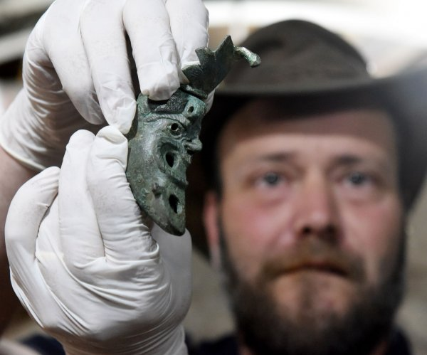 Israeli archaeologists uncover rare bronze lamp shaped like face