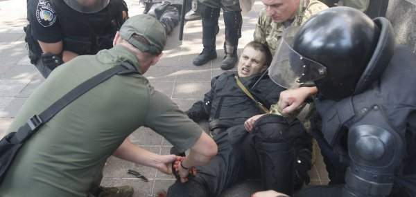 Ukrainian riot police and protesters clash