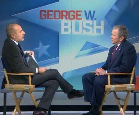 Bush defends media, says 'we all need answers' about Russia