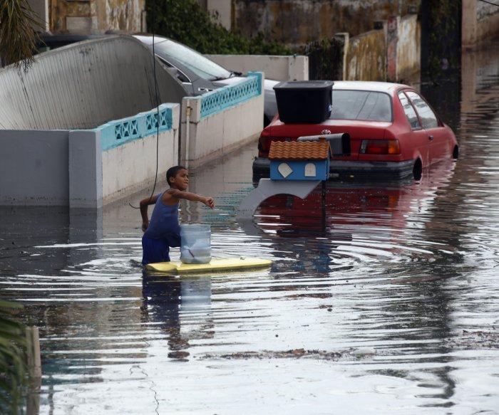 Puerto Rico evacuates western towns as dam fails