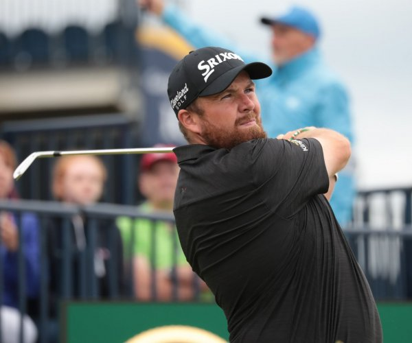 British Open: Shane Lowry enters final day with four-shot lead