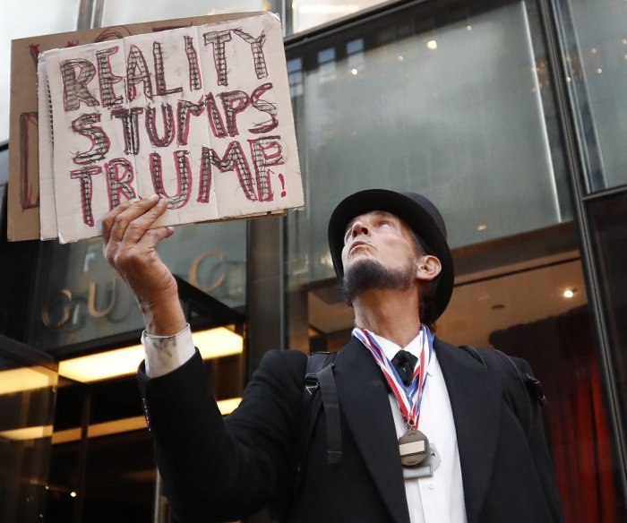 Anti-Trump protesters descend on Trump properties in Las Vegas and NYC
