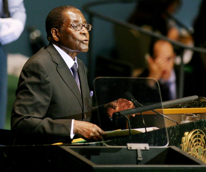 Robert Mugabe vows to stay in power after party vote