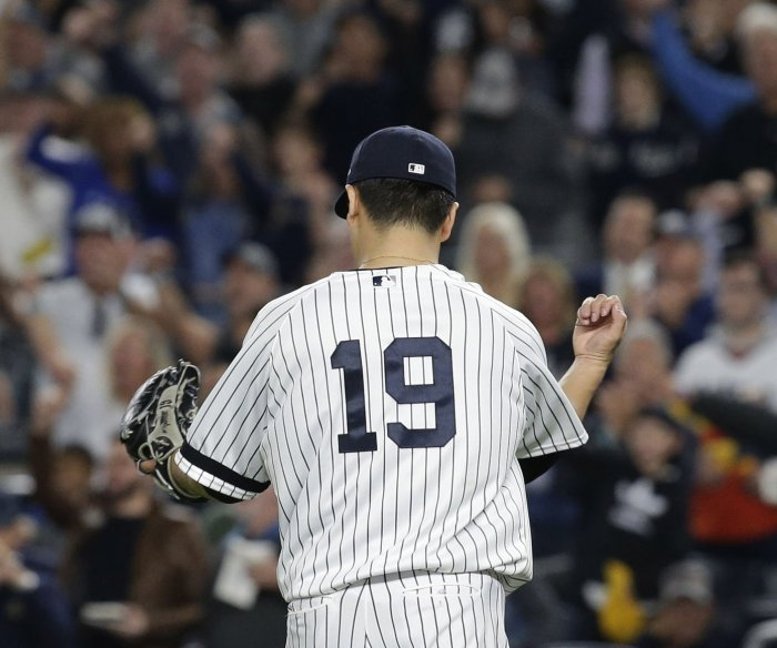 Yankees seize lead with 5-0 win over Astros