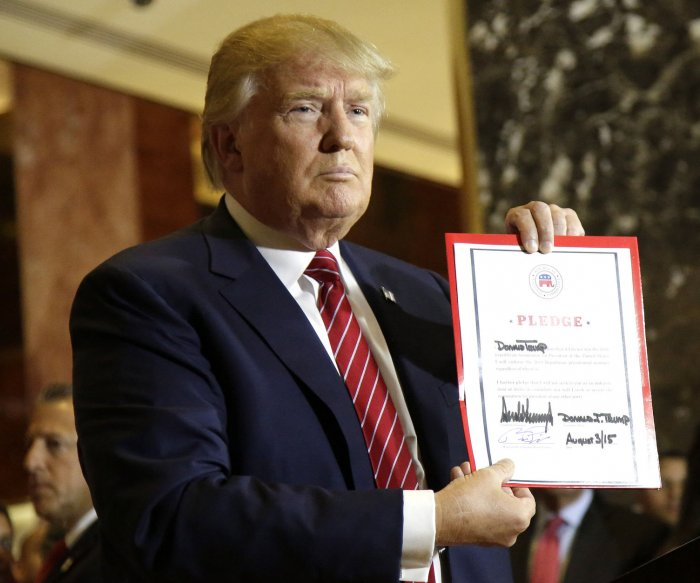 Donald Trump signs RNC loyalty pledge