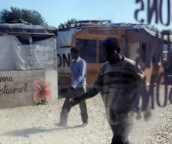 Life inside Calais' illegal migrant camp known as 'The Jungle'