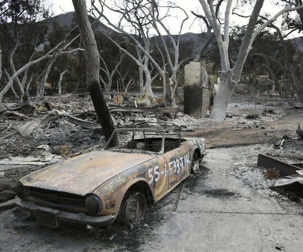 Firefighters in California combat Woolsey Fire flare-up