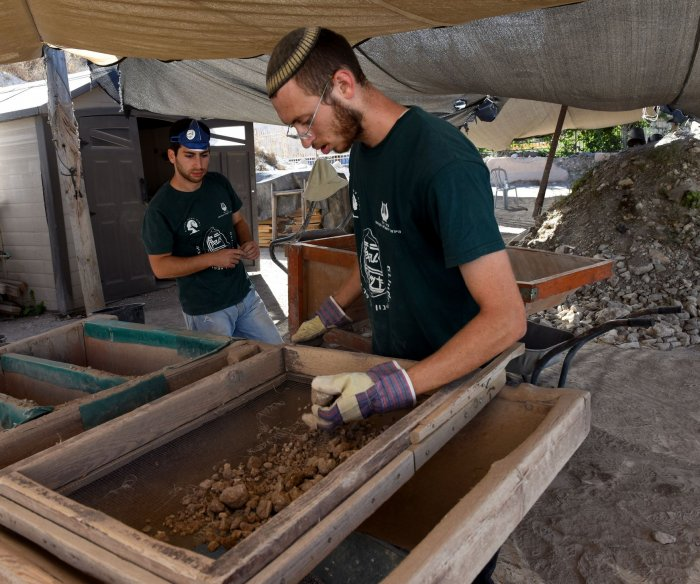 Israeli archaeologists sift through debris from the Temple Mount