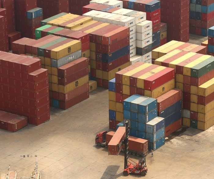 China slams U.S. 'intimidation' as new tariffs kick in
