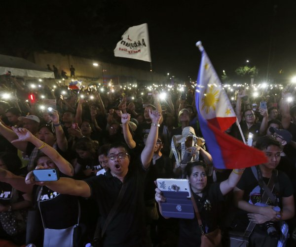 Philippines protesters gather on anniversary of political uprising