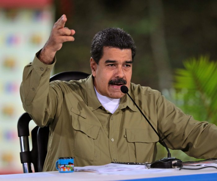Venezuelans vote in election expected to keep Maduro in power