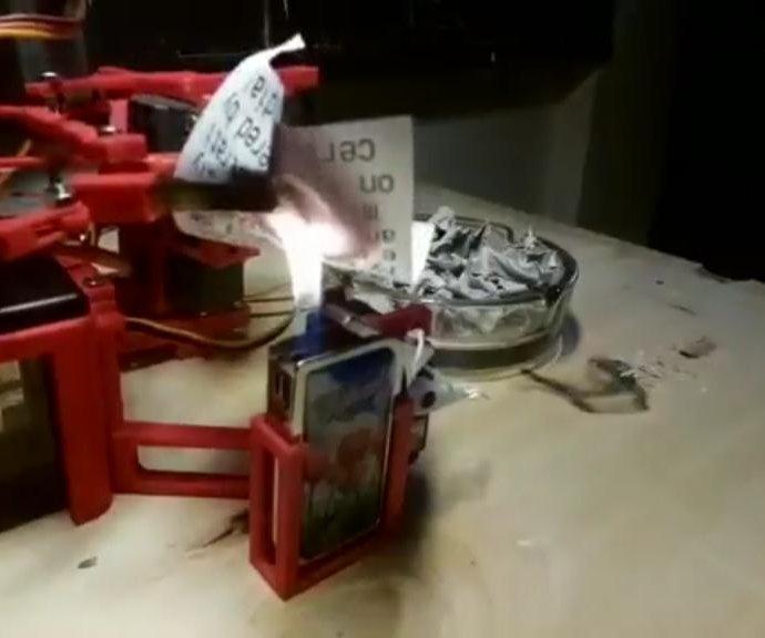 Robot prints and burns Trump's tweets, sends him video