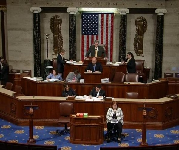 House delays vote on immigration bill
