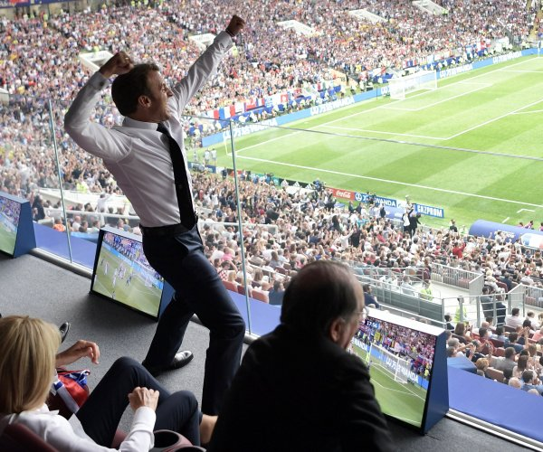 Emmanuel Macron jumps on table, cheers at World Cup