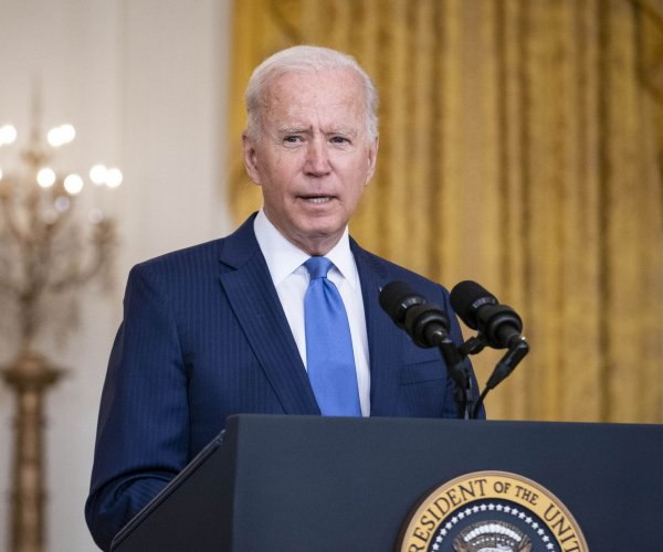 Biden asks big corporations to pay their 'fair share' in taxes