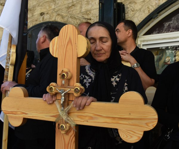 Orthodox Christians carry crosses on Good Friday in Jerusalem