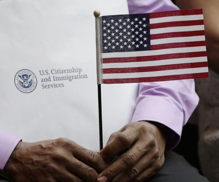 U.S. gov't allows only phone interpreters for refugees to limit virus spread