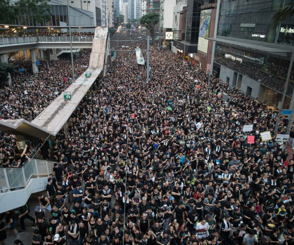 Protesters want Hong Kong leader out despite extradition apology