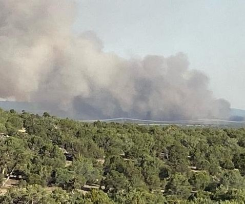 High heat, drought conditions fuel dozens of wildfires in western U.S.