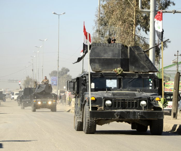 Iraqi forces moving toward Mosul Airport after taking strategic hill