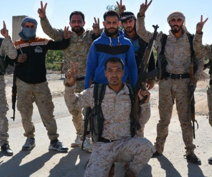 U.S.-backed forces celebrate full liberation of Raqqa