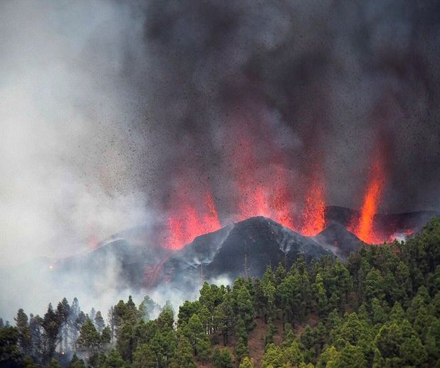 At least 100 homes destroyed after volcano erupts in Canary Islands
