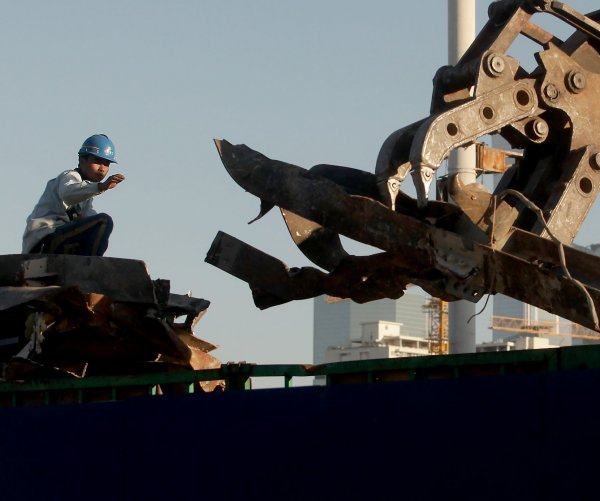 China's GDP grows 4.9% in Q3