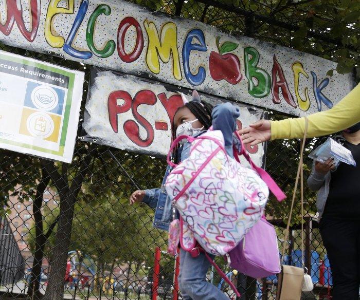 Children return to NYC schools; U.S. adds 33K COVID-19 cases