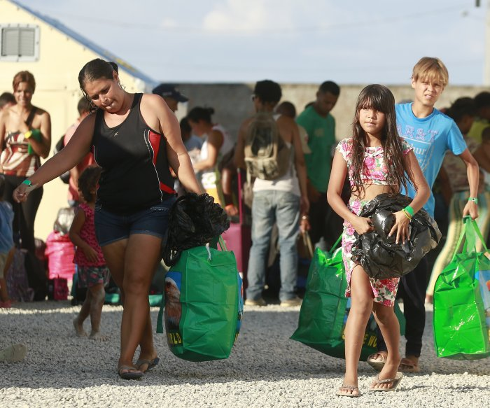 Venezuelan refugees fleeing to Latin American cities, not camps