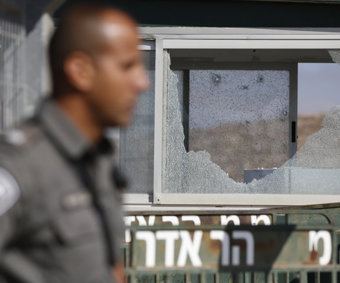 Israel seals off West Bank town after 3 officers shot dead