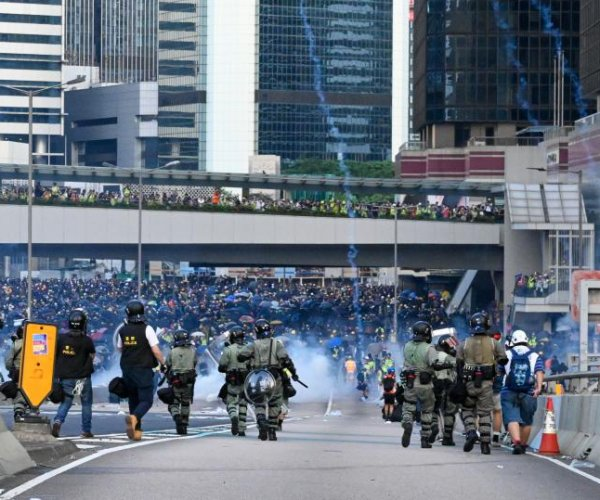Defying ban, protesters march in Hong Kong, clash with police