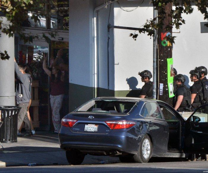 Women dies, gunman surrenders after L.A. Trader Joe's standoff