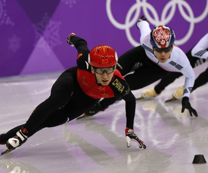 China's Dajing grabs gold with record in 500m short track