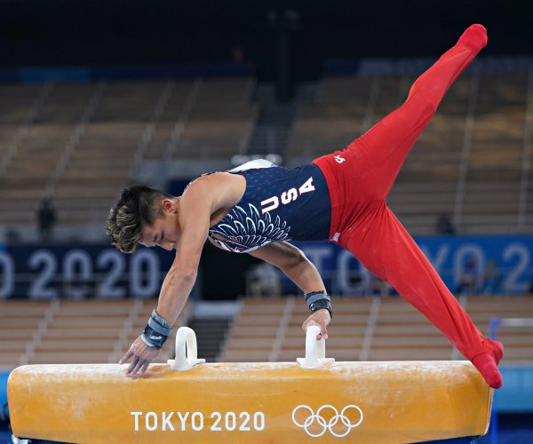 Shooters, swimmers add to U.S. medal count, men's gymnasts miss podium