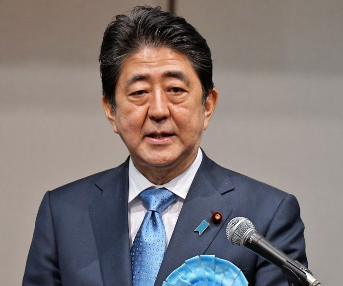 Japan's Abe orders breakup of parliament, snap election