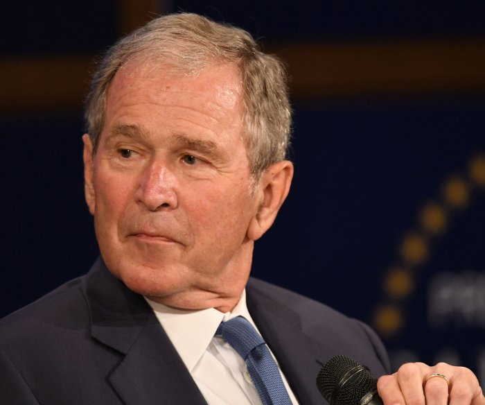 George W. Bush condemns bigotry, Russian interference
