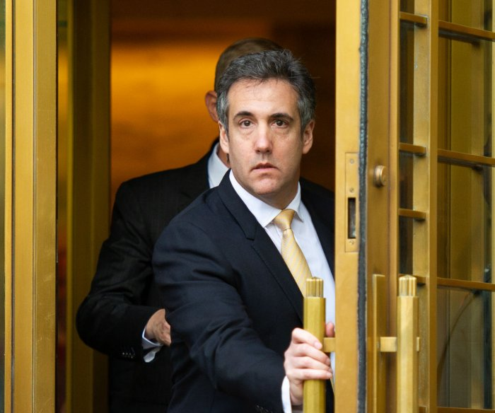 Michael Cohen says he paid IT firm to 'rig' polls to favor Trump
